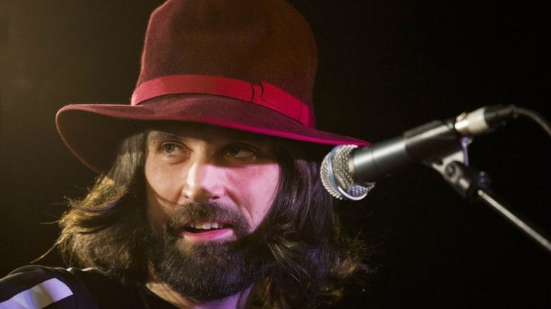 serge on stage in a hat