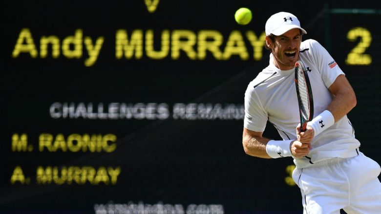 Andy Murray returns a serve in the Wimbledon Final