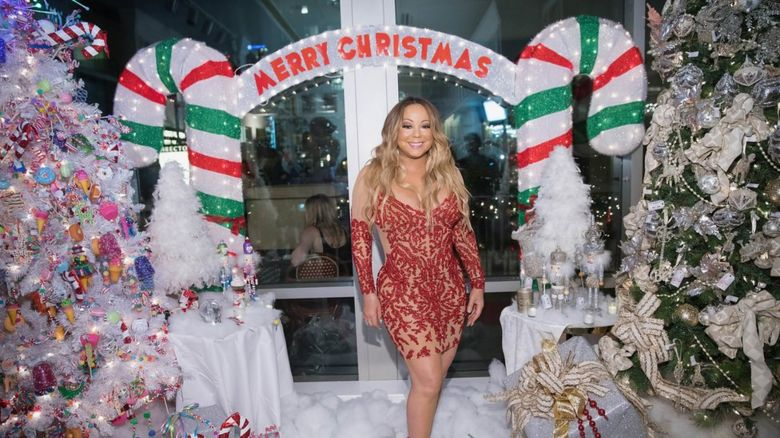 Mariah Carey in a Christmas grotto