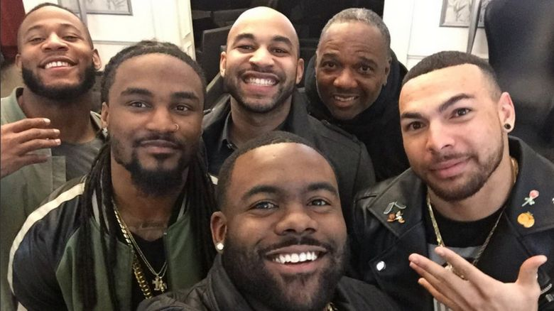 This is a photo of Mark Ingram and five of his team mates form the New Orleans Saints.