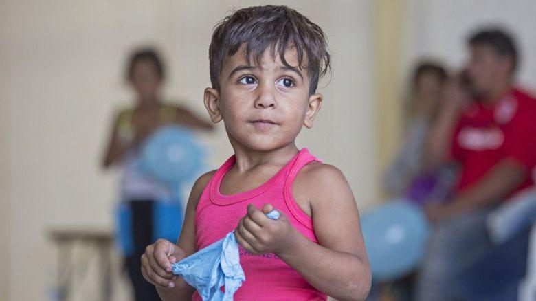 A young refugee housed at RAF base Akrotiri in Cyprus