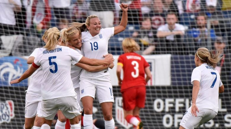 Toni Duggan celebrates an England goal with teammates