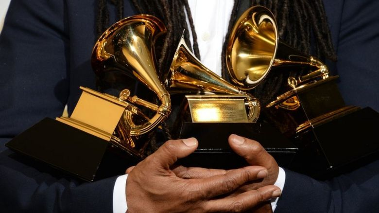 Nile Rogers holding his Grammy Awards