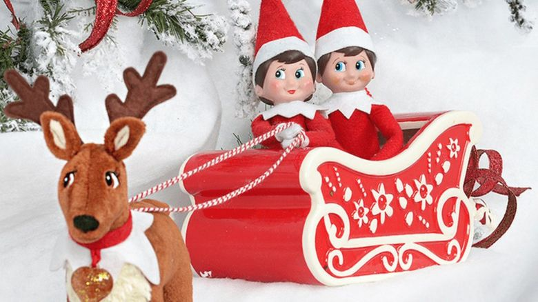 Elf on a Shelf in a sleigh