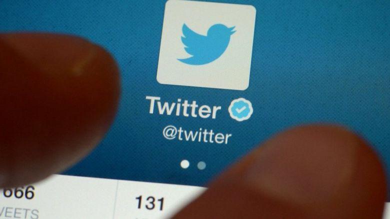 Twitter logo on mobile phone