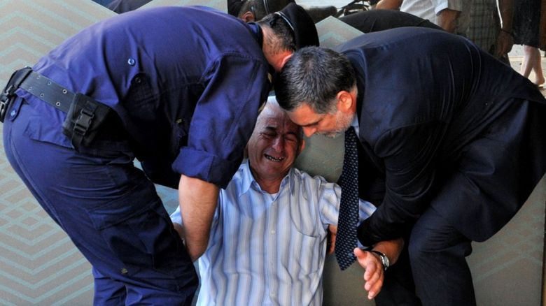 Man crying in Greece
