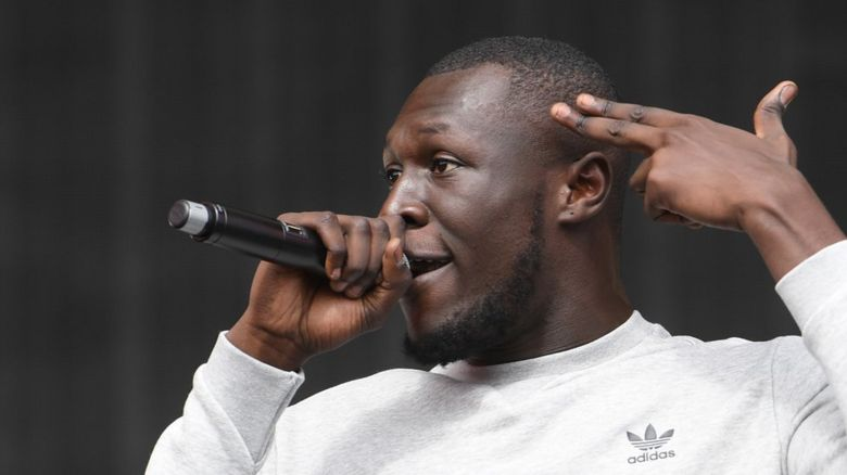 Stormzy performing at a concert