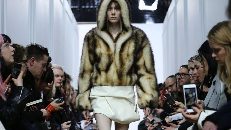 A model wearing a J W Anderson fur coat at London Fashion Week 2016