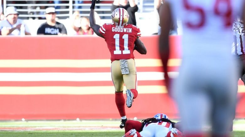 Marquise Goodwin races away to score