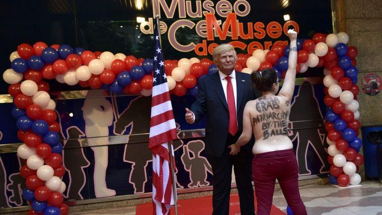 Woman grabbing Donald Trump waxwork