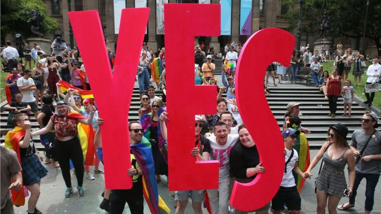 People celebrate after the announcement of the same-sex marriage postal survey result