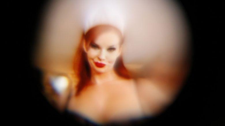 A woman viewed through a peephole