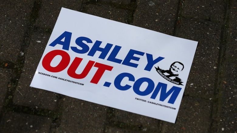 A poster saying AshleyOut.Com