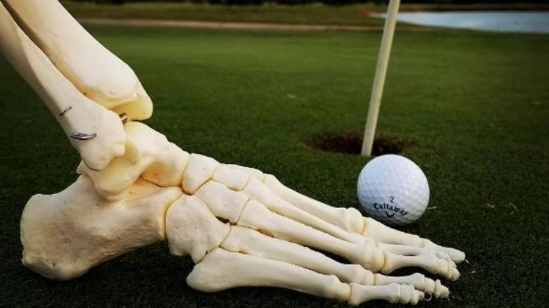 foot on golf course