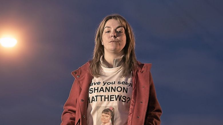 Sheridan Smith as Julie Bushby, wearing a Shannon Matthews tshirt
