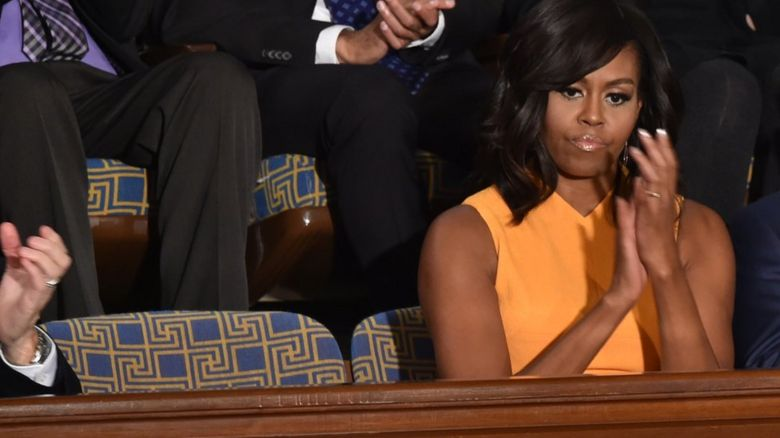 The First Lady sits next to an empty chair
