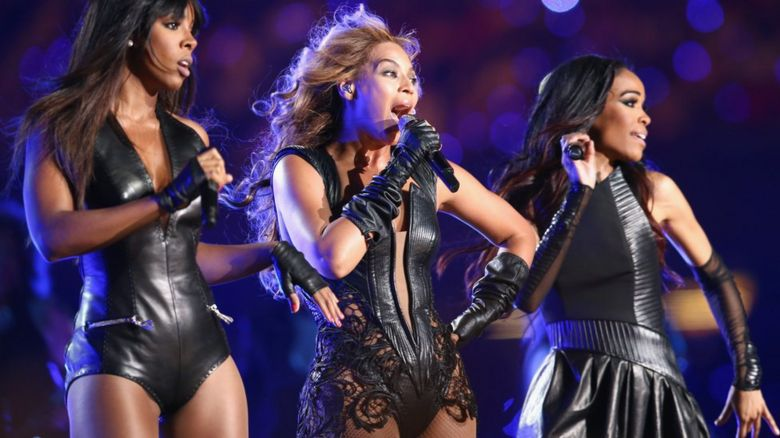 This is a photo of Destiny's Child performing together during Beyonce's Superbowl performance.