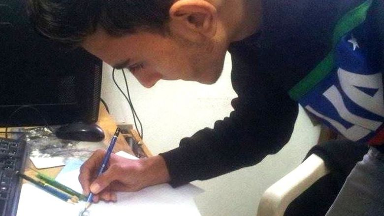 Oussema drawing a picture