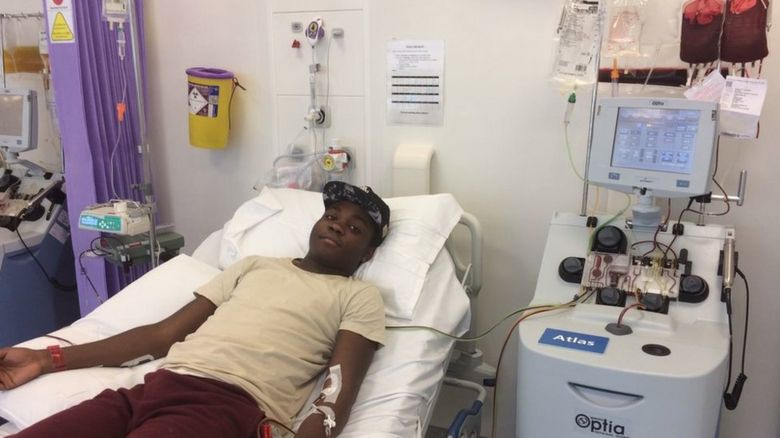 Tre Adegoroye having a blood transfusion
