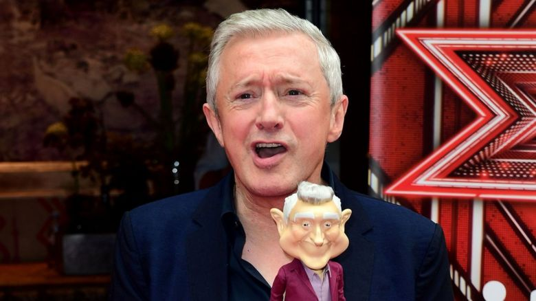 Louis Walsh and a doll of his face
