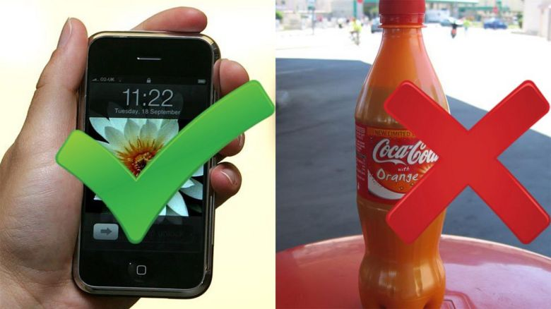 An iPhone and a bottle of Coke Orange