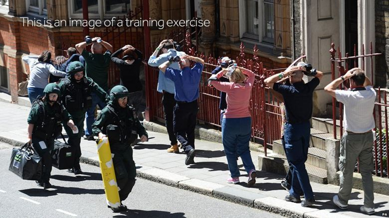 Actors being led to safety