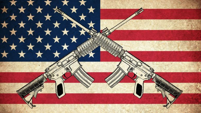 Guns on top of an American flag