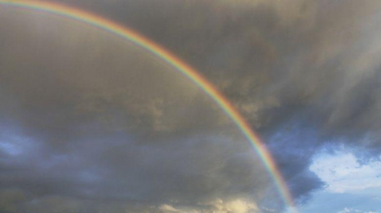 Rainbow with dark clouds