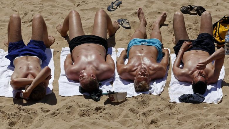 Young Brits sunbathing in Majorca