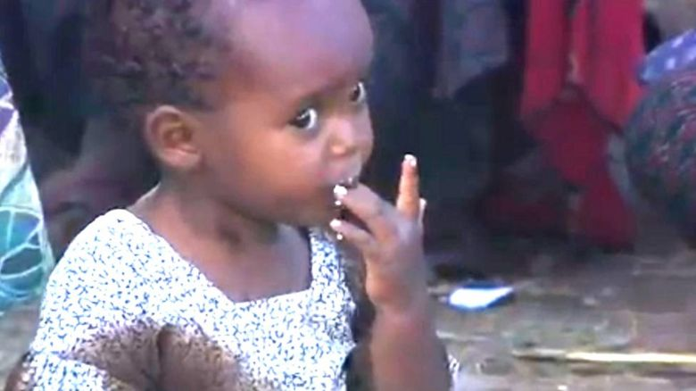 Child eating with her hands