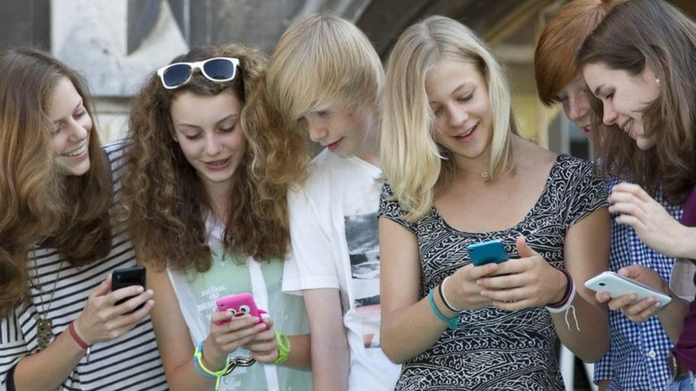 Young women looking at mobile phones