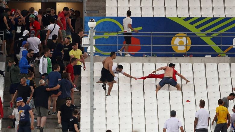England fans run from Russian hooligans inside a stadium at Euro 2016
