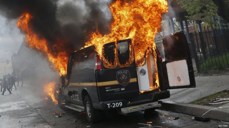 Police van burning
