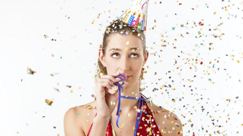 A woman in a party hat
