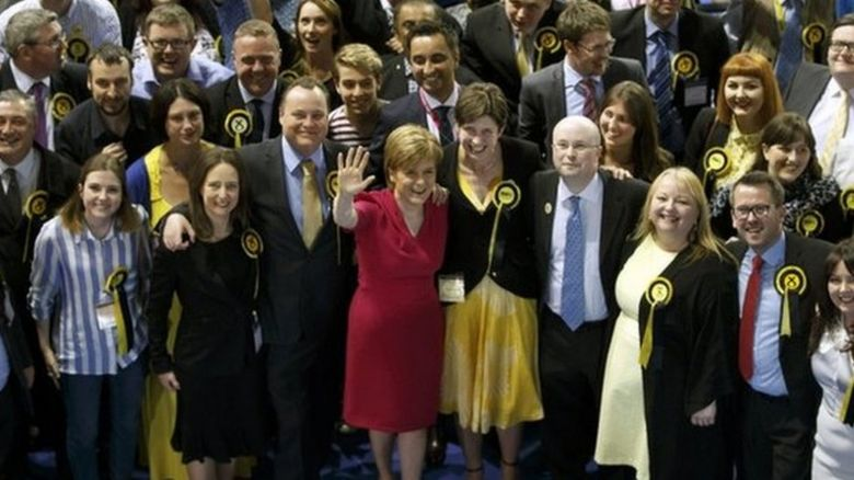 Scottish National Party (SNP) leader Nicola Sturgeon (C-L) celebrates with the seven new MPs for Glasgow