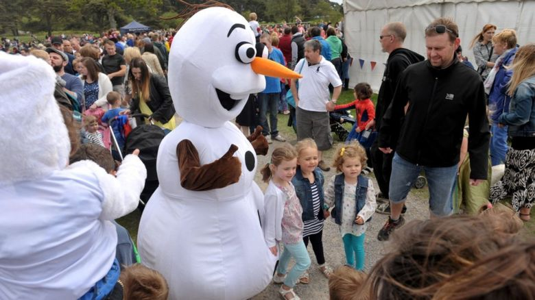 Olaf character surrounded by children