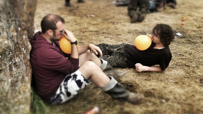 People inhaling laughing gas at Glastonbury