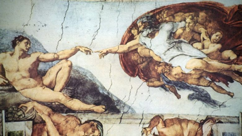 The painting on the ceiling of the Sistine Chapel showing God touching Adam