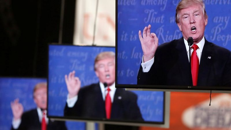 Republican U.S. presidential nominee Donald Trump is shown on TV monitors in the media filing room on the campus of University of Nevada, Las Vegas, during the last 2016 U.S. presidential debate in Las Vegas, U.S., October 19, 2016