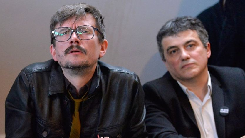 Charlie Hebdo cartoonist, Renald Luzier (C) aka Luz and Patrick Pelloux (R), Charlie Hebdo journalist, during the Charlie Hebdo press conference held at the Liberation offices in Paris on January 13, 2015 in Paris, France