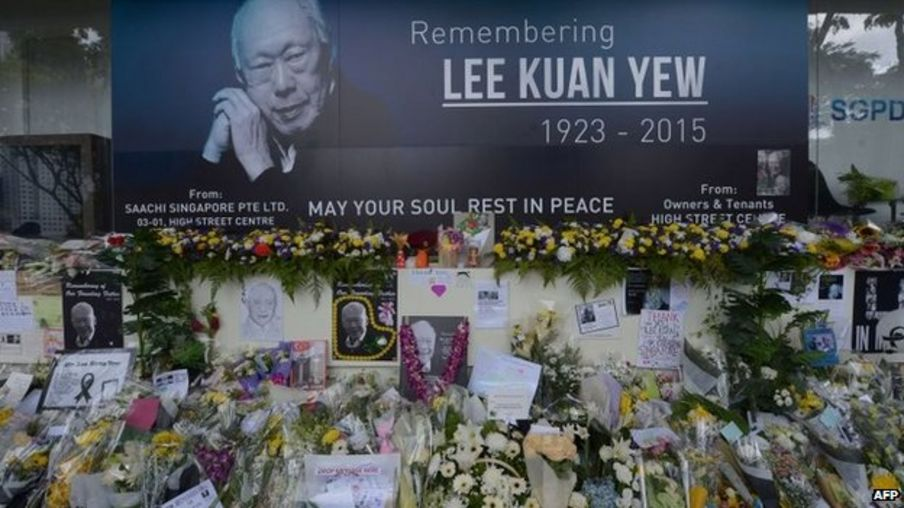 Pictures and flowers are seen in front of a memorial area for Singapore's late former prime minister Lee Kuan Yew outside the parliament building where he lies in state ahead of his funeral in Singapore, 28 March 2015