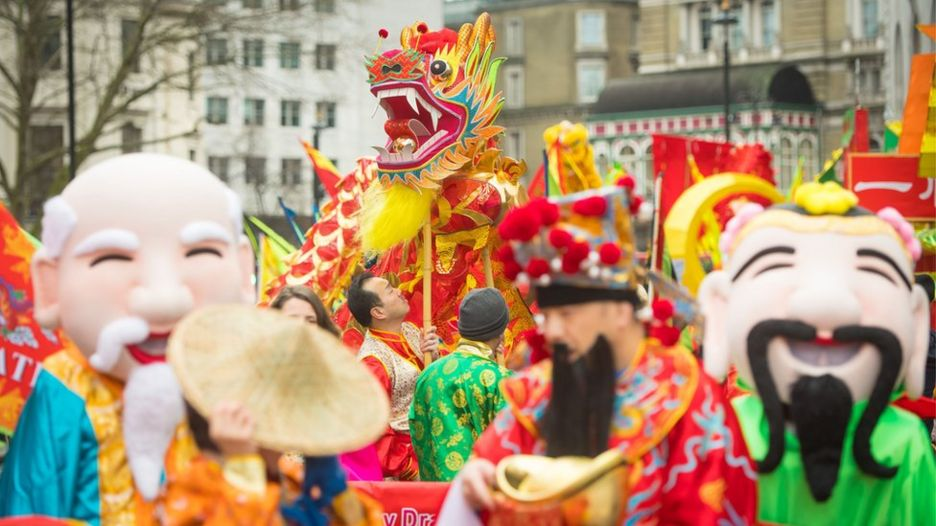 Performers await the start of the Chinese New Year parade in London