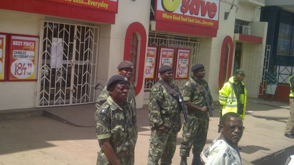 police guard South African shops in Blantyre were under heavy security on Friday