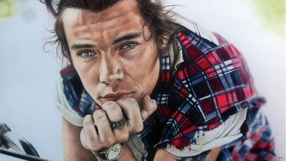 A teenager has quit school after his portraits of One Direction went viral.