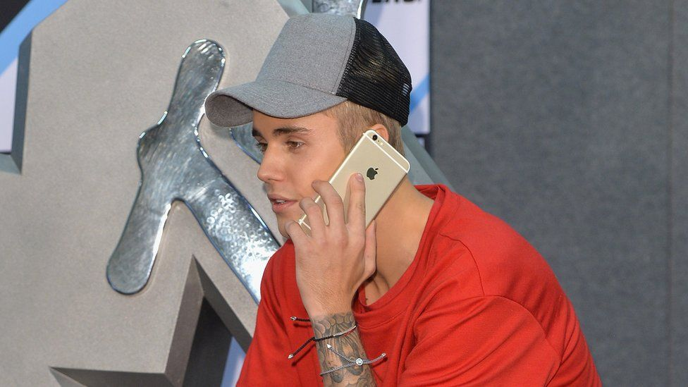 Bieber on the phone
