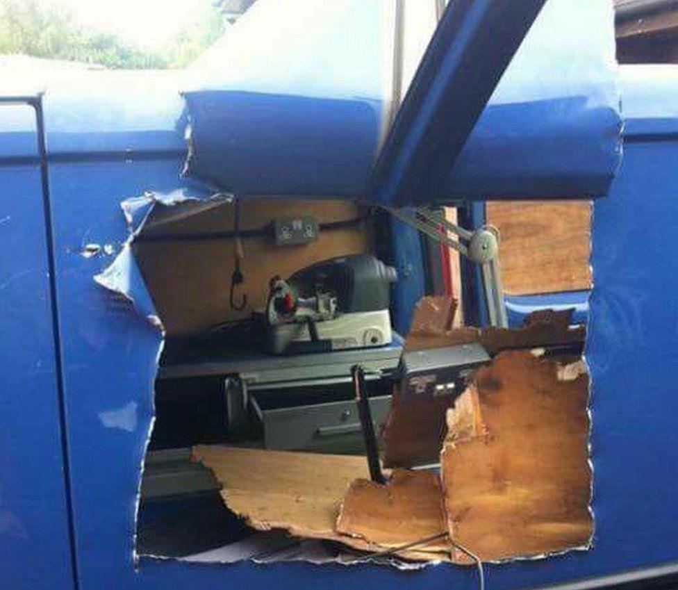 Van side ripped open
