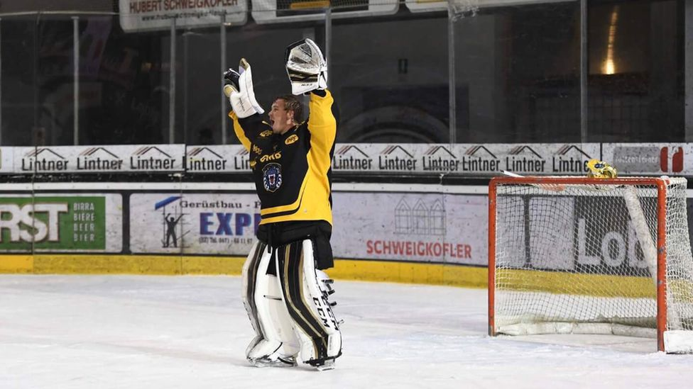 This is a photo of the Nottingham Panthers goal keeper celebrating as the team scored the winning goal.