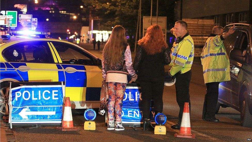 Police talking to Ariana Grande concert-goers