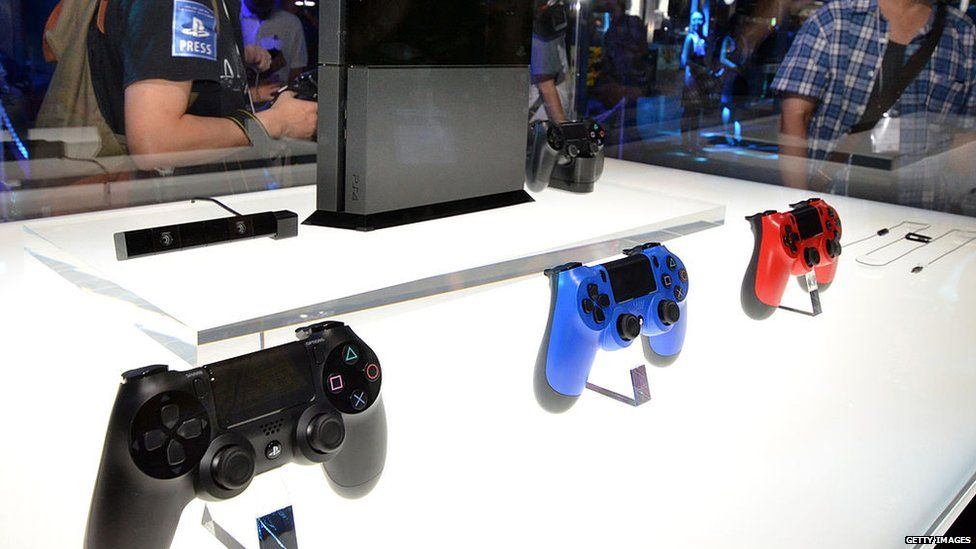 A PS4 console and controllers