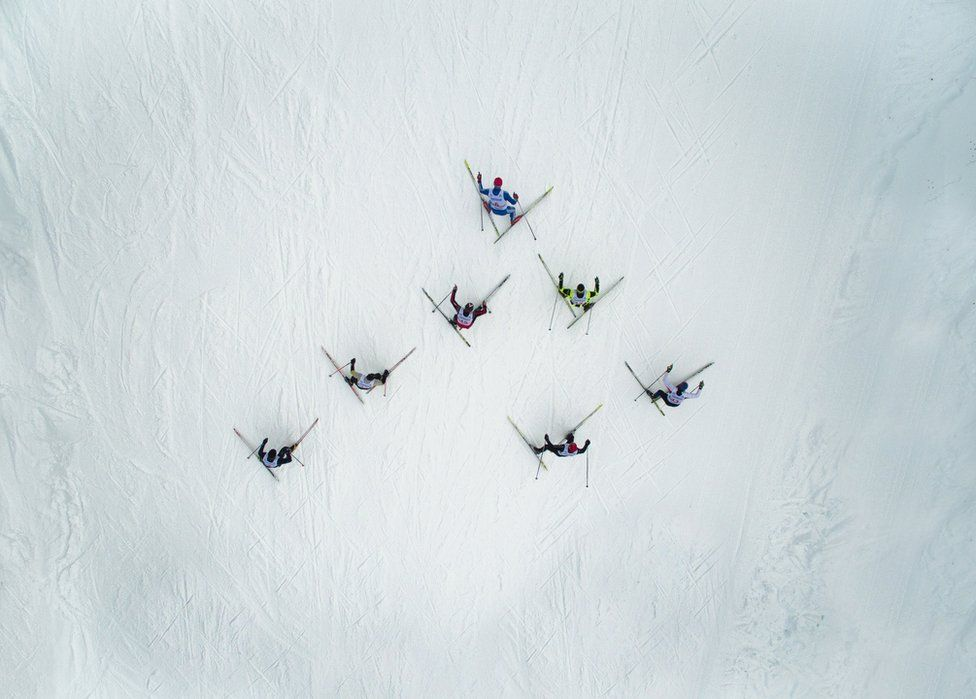 A triangle of skiers from above